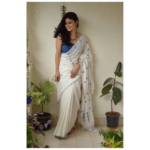 Handwoven muslin line jamdani saree with bootis.