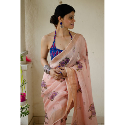 Handblocked printed handloom linen by linen saree with gold/silver zari border.