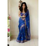 Handblocked printed handloom linen by linen saree with goldsilver zari border.