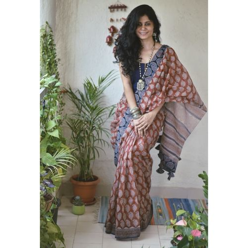 Hand block printed kota doria saree with Ajrakh patch work border and tassel.