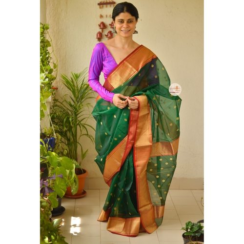 Handwoven chanderi katan silk saree with gold jari woven border and jari bootis motifs.