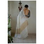 Handloom linen saree with jari stripes and border.