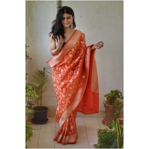 Handwoven katan silk banarasi saree with handwoven motifs.
