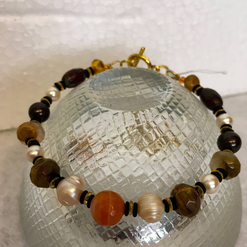 Earth toned bracelet featuring multiple gems