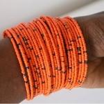 Orange  beaded African coil bangle