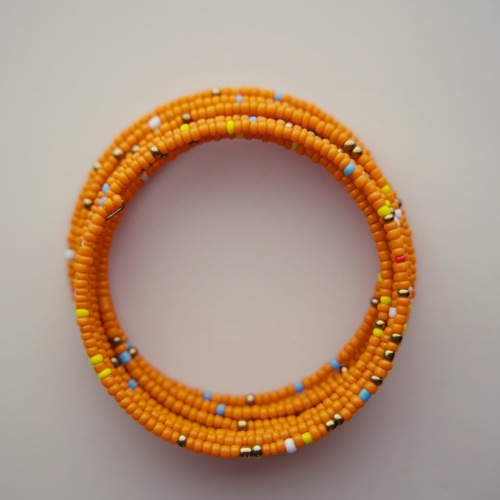 Orange  beaded African coil bracelets
