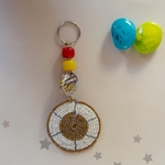 white and golden beaded keychain