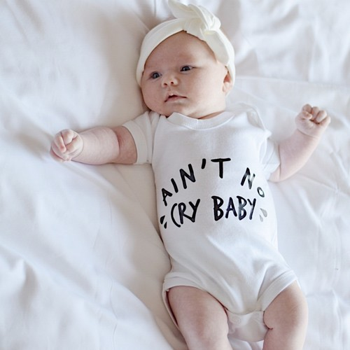 AIN'T NO CRY BABY Unisex Bodysuit
