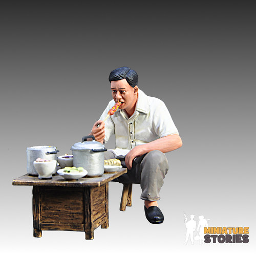 Satay Customer Eating at Table Figurine