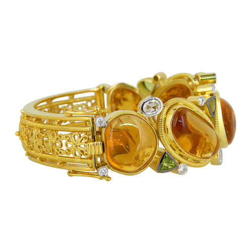 A Grand citrine cabochon yellow gold diamond parure befitting a ceremonius occasion