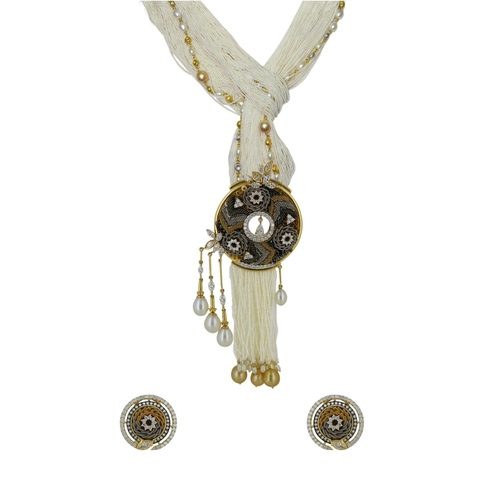 An opulent knotted keshi pearl necklace ,matching earrings and ring, made with embroidered precious elements