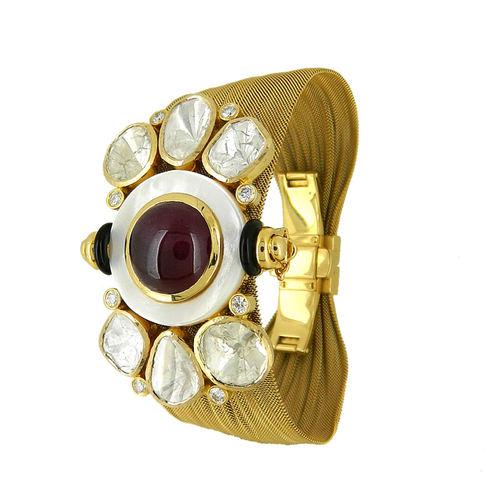 A Grand Parure in Ruby, Un-cut Diamonds and diamond in yellow gold