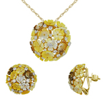 A pair of beautiful floral mother of pearl tops and matching pendant that doubles up as a cocktail ring