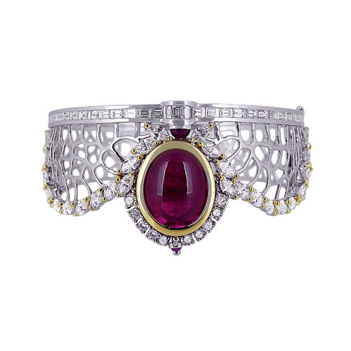 Broad Gold lattice work bracelets adorned with striking centre gem surrounded with diamonds