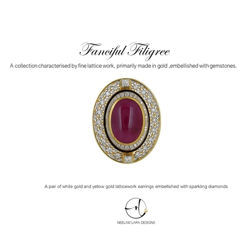 A Classic diamond filigree pendant with a large centre ruby cabochon