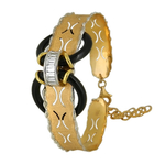 A stylish textured matte Italian gold bracelet with unusual placement of gemstones
