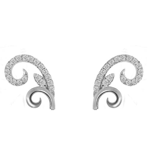 A pair of daily wear oriental motif earrings in whitegold with matching oval shaped sliding bracelet, befitting office wear