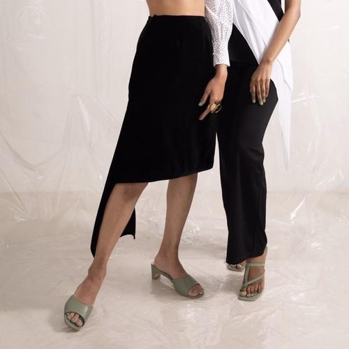 Black velvet asymmetric skirt