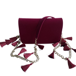 Front view of TASSIE ruby velvet crossbody bag with tassels