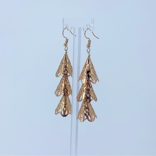 Side view of RAJNI rose gold tone tier-drop earrings