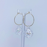 Side view of BOBBIE small bauble ear hoops