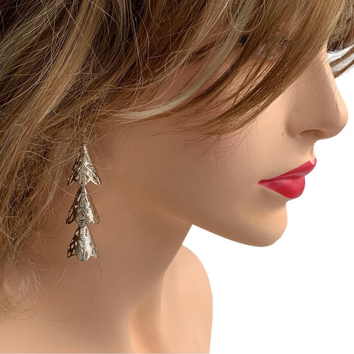 Model wearing RAJNI silver tone tier-drop earrings