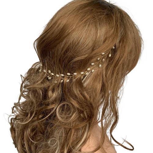 Model wearing VINI modular pearl vine necklace as a hair wreath