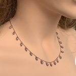 Side view of RIZZO grey rice pearl chain necklace