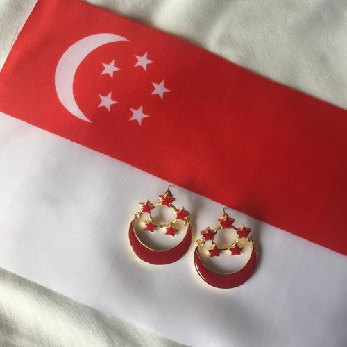 SINGAPORE ENSIGN earrings pictured with the Singapore Flag.
