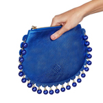 Side view of CHARMAINE round blue clutch bag with pearls