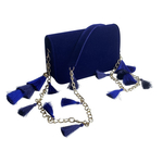Side view of the TASSIE royal blue velvet crossbody bag with tassels