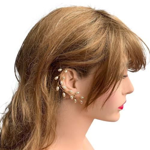 Model wearing VINI modular pearl vine earrings as ear cuffs