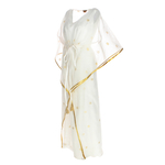 Side view of JEWEL white kaftan resort maxi dress set