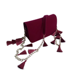Side view of the TASSIE ruby velvet crossbody bag with tassels