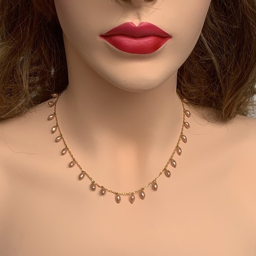 Front view of model wearing RIZZO pink rice pearl chain necklace