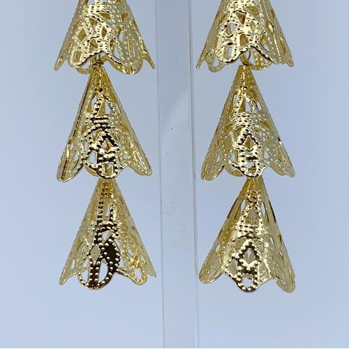 Close up view of RAJNI gold tone tier-drop earrings