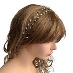 Model wearing VINI modular pearl vine necklace as a headband