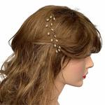 Model wearing VINI modular pearl vine ear cuffs as hair barette