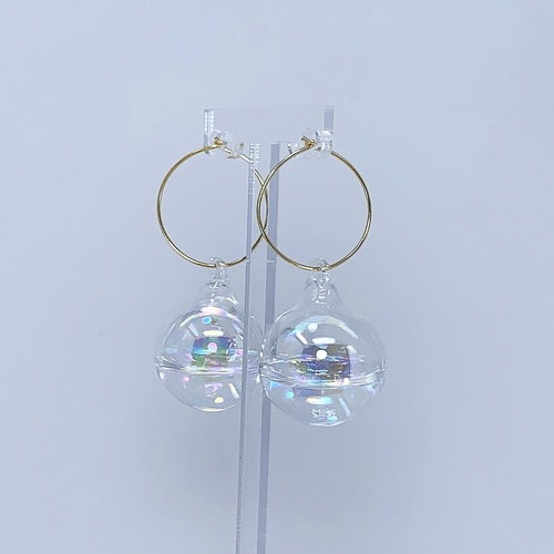 Side view of BOBBIE large bauble ear hoops