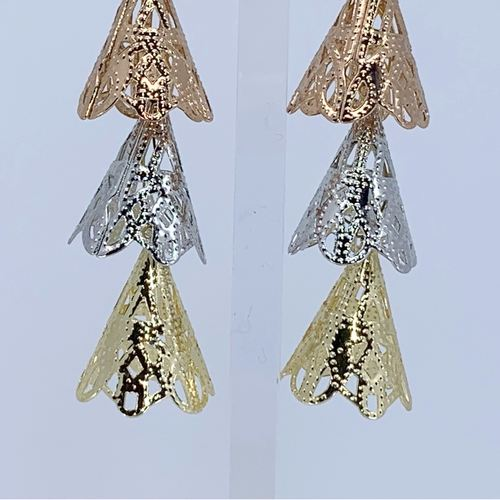 Close up view of RAJNI triple tone tier-drop earrings