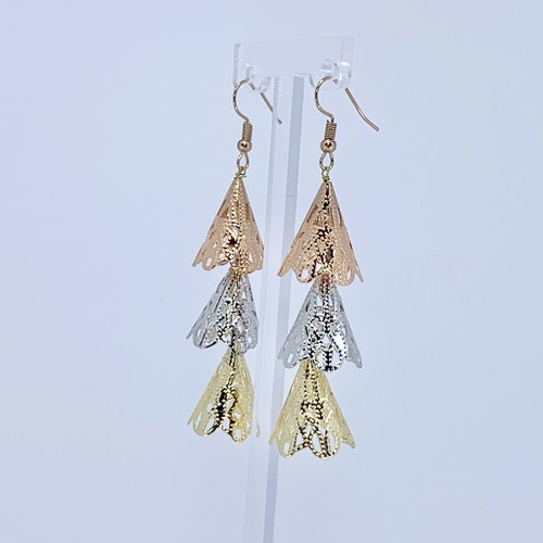 Side view of RAJNI triple tone tier-drop earrings