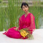 Model wearing JEWEL pink kaftan resort maxi dress set