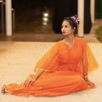 Model wearing JEWEL orange kaftan resort maxi dress set
