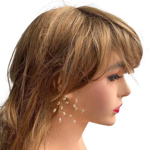 Model wearing VINI modular pearl vine ear cuffs as hoops
