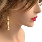 Model wearing RAJNI gold tone tier-drop earrings