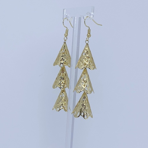 Side view of RAJNI gold tone tier-drop earrings