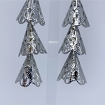 Close up view of RAJNI silver tone tier-drop earrings