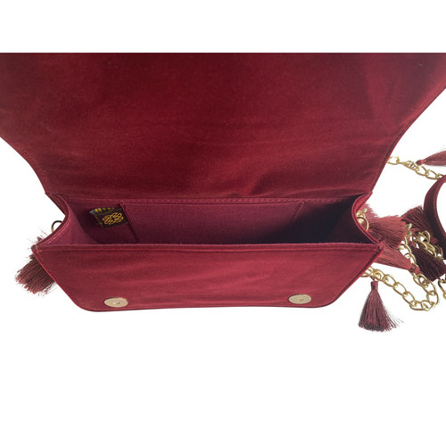 Interior view of the TASSIE burgundy velvet crossbody bag with tassels