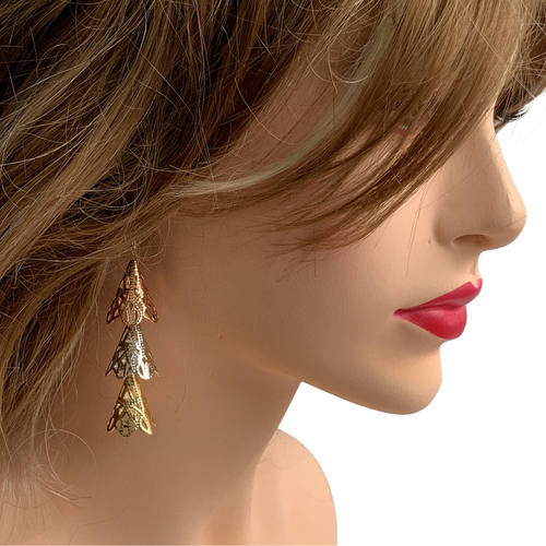 Model wearing RAJNI triple tone tier-drop earrings