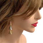 Model wearing RAJNI triple tone tier-drop earrings